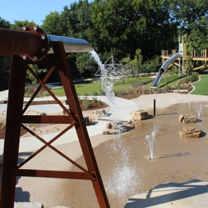 Cool off at the nature-inspired water feature at Indian Camp Creek Park.